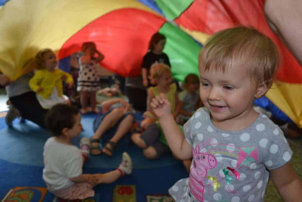 Toddler group under the parachute