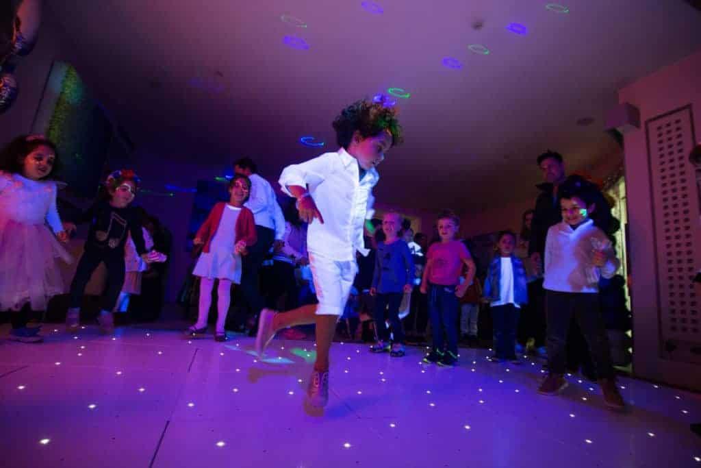 Child dancing at Mega DJ party
