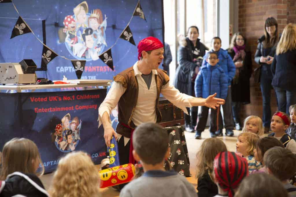 Children engrossed by pirate childrens entertainer
