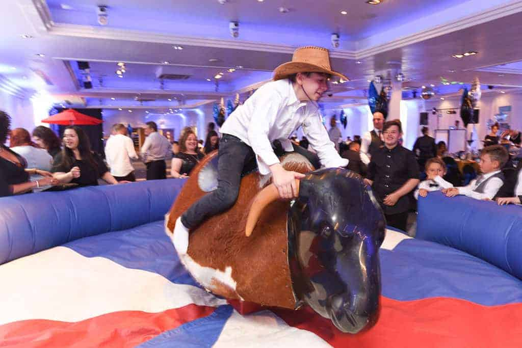 Mechanical bull at a corporate family fun day