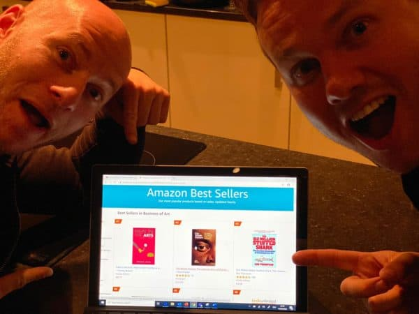 Rick and Tommy showing Pain the Arts Book as Amazon Best Seller